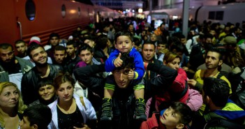 epa04917510 Recently arrived refugees at the main train station in Munich, Germany, 06 September 2015. Thousands more exhausted refugees were setting foot in Germany for the second day 06 September after enduring grueling journeys across Hungary and Austria. Many of the refugees are fleeing war-torn countries such as Syria and Afghanistan, and thus qualify for international protection, but EU countries disagree on how to best handle the surge.  EPA/SVEN HOPPE